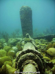 The prop shaft on the wreck of the Kate, a steamer that s... by Jonathan Whitefield 